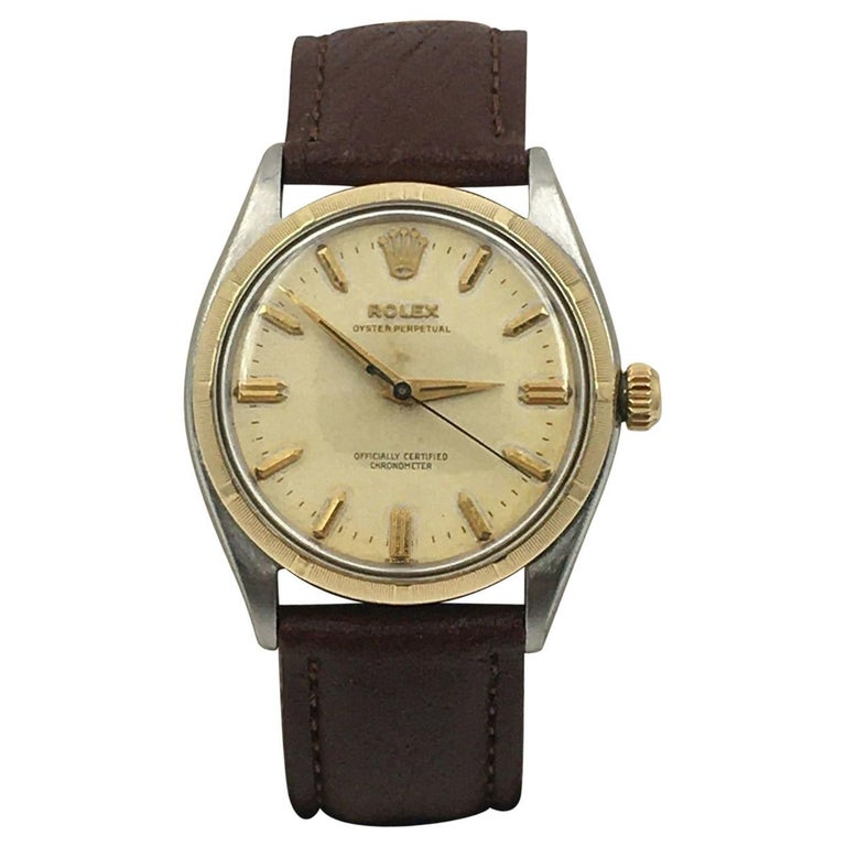 Rolex 6565 Oyster Perpetual 14 Karat Yellow Gold Stainless Steel For Sale