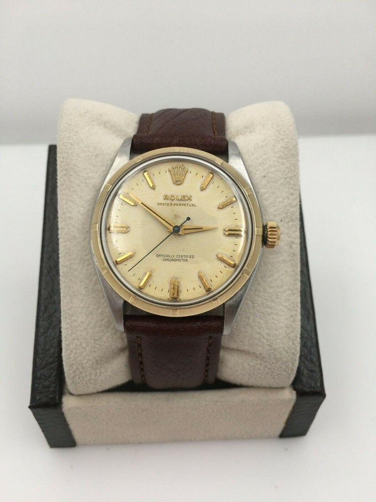 Style Number: 6565     Serial: 358***    Year: 1946 Estimated     Model: Oyster Perpetual     Case Material: Stainless Steel     Band: Custom Leather Band     Bezel:  14k Yellow Gold     Dial: Ivory     Face: Acrylic Crystal     Case Size: 34mm