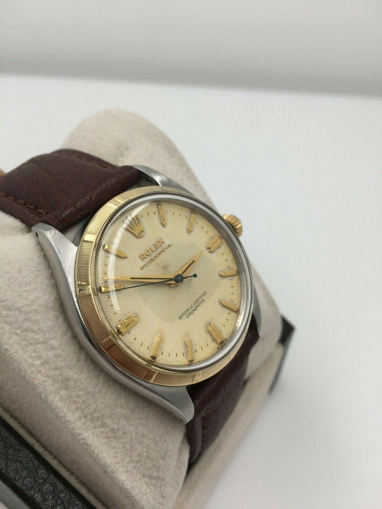 Rolex 6565 Oyster Perpetual 14 Karat Yellow Gold Stainless Steel In Good Condition For Sale In San Diego, CA