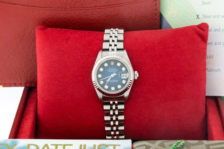 Ladies 26mm Rolex stainless steel Datejust watch model ref #79174 with a genuine Blue vignette diamond dial and Rolex 18k Gold fluted bezel. This genuine Rolex has a genuine Rolex stainless steel Jubilee band.   WATCH INFORMATION   DIAL