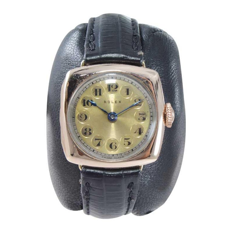 FACTORY / HOUSE: Rolex Watch Company STYLE / REFERENCE: Cushion Shape  METAL / MATERIAL: 9Ct. Solid Gold  CIRCA / YEAR: 1915 DIMENSIONS / SIZE: 30mm x25mm MOVEMENT / CALIBER: Manual Winding / 15 Jewels  DIAL / HANDS: Original with Cartouche Numbers