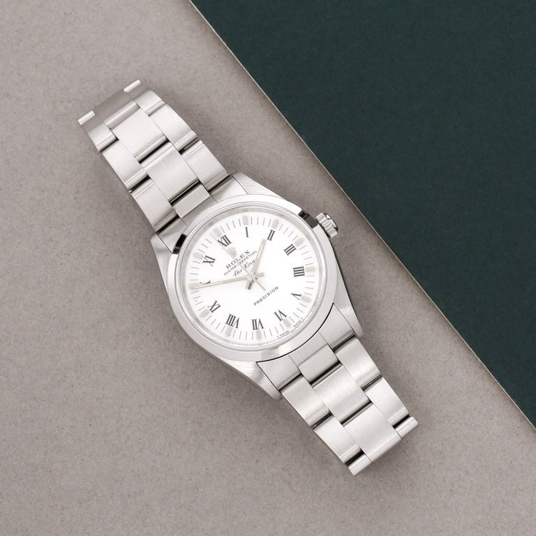 Xupes Reference: W007576 Manufacturer: Rolex Model: Air-King Model Variant: 0 Model Number: 14000 Age: 1997 Gender: Men Complete With: Rolex Service Pouch  Dial: Silver Baton Glass: Sapphire Crystal Case Size: 34mm Case Material: Stainless