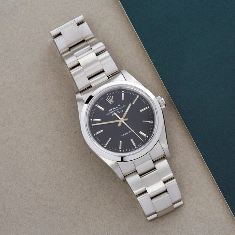Xupes Reference: W007584 Manufacturer: Rolex Model: Air-King Model Variant: 0 Model Number: 14000 Age: 1991 Gender: Men Complete With: Rolex Service Pouch  Dial: Black Baton Glass: Sapphire Crystal Case Size: 34mm Case Material: Stainless