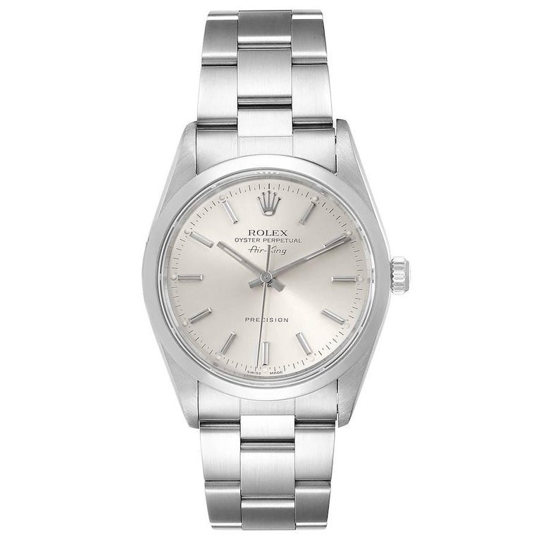 Rolex Air King 34mm Silver Dial Smooth Bezel Steel Mens Watch 14000. Automatic self-winding movement. Stainless steel case 34.0 mm in diameter. Rolex logo on a crown. Stainless steel smooth domed bezel. Scratch resistant sapphire crystal. Silver