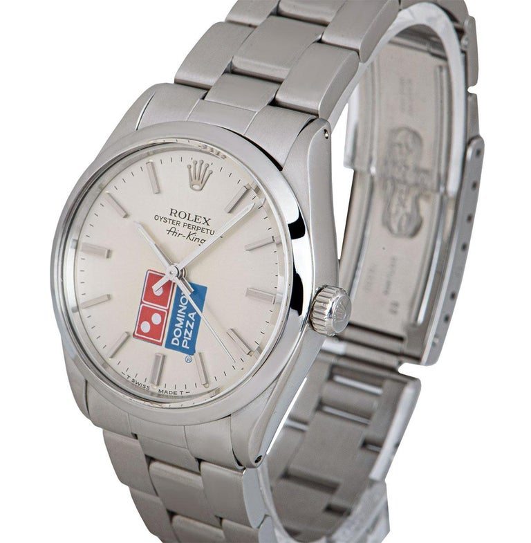 A 34 mm Stainless Steel Oyster Perpetual Air-King Gents Wristwatch, silver dial with applied hour markers, Domino's Pizza logo at 6 0'clock, a fixed stainless steel smooth bezel, a stainless steel oyster bracelet with a stainless steel deployant