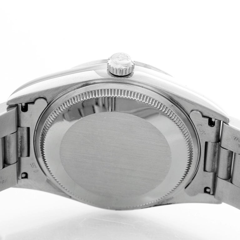Rolex Air King Stainless Steel Men's Watch 14000 - Automatic winding. Stainless Steel ( 34 mm ). Salmon dial with white stick hour markers. Stainless Steel Oyster bracelet. Pre-owned with custom box