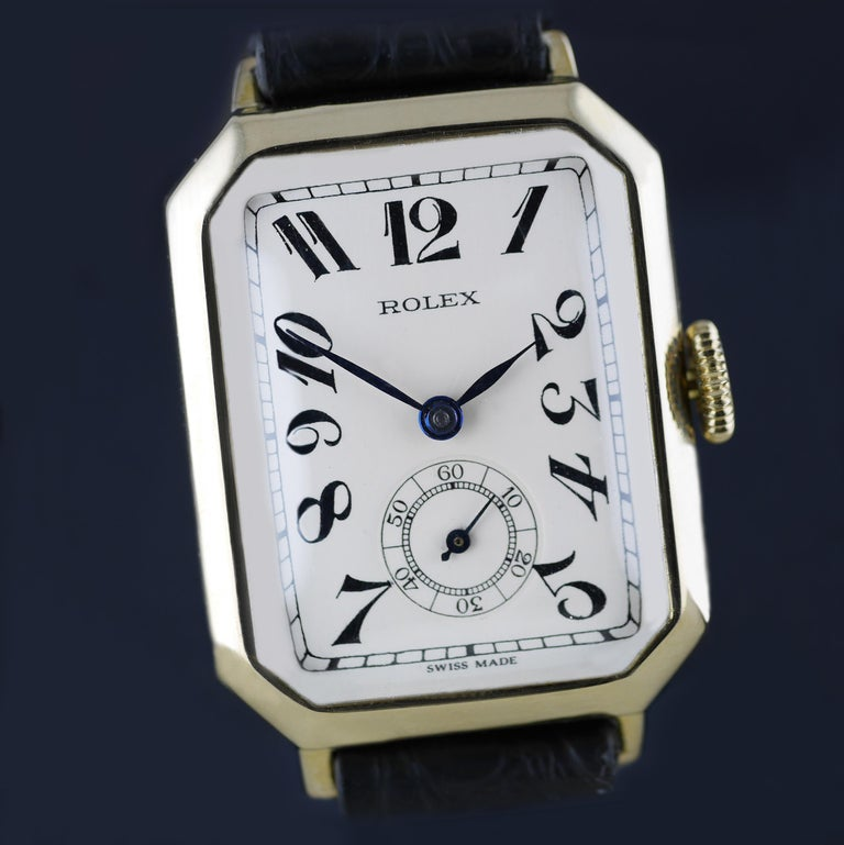 "An Art Deco vintage wristwatch by Rolex made in 1933. This unusual and rare Rolex, with a distinctive shaped case, was made in the height of the Art Deco era.   Gold rectangular shaped case marked with the ""RWC Ltd"" lozenge for the Rolex Watch"