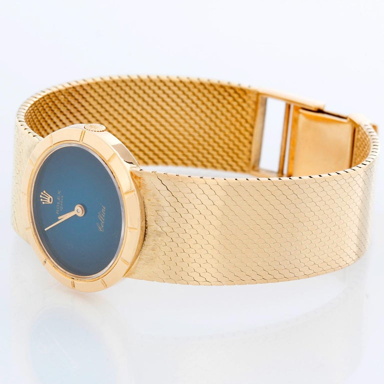 Rolex Cellini 18k Yellow Gold Ladies Dress Watch - Manual winding. 18k yellow gold case (32mm diameter). Blue dial with gold hands. Integrated gold mesh style bracelet (6 1/2 inches). Pre-owned with custom box.