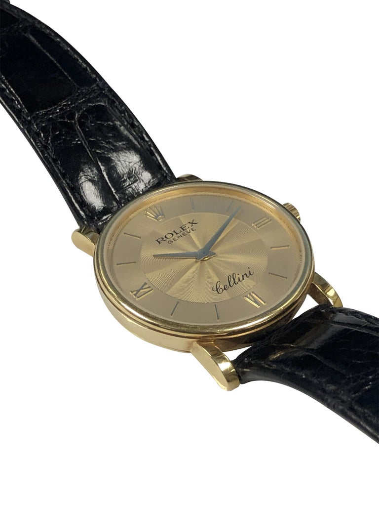 Circa 2001 Rolex Cellini Reference 5115 Wrist watch, 32 M.M. 18K Yellow Gold 2 Piece Case, Mechanical Manual wind movement. Gold Dial with Engine turned center and Raised markers. Original Black Crocodile strap with 18K Gold Rolex buckle. Original