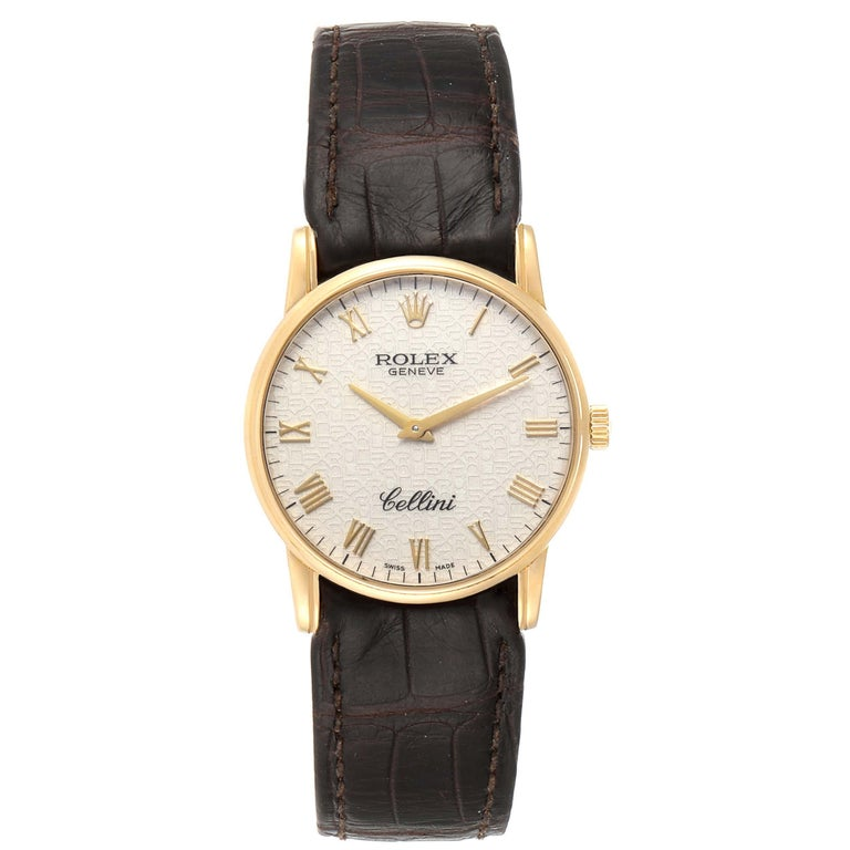 Rolex Cellini Classic Yellow Gold Anniversary Dial Brown Strap Watch 5116. Manual winding movement. 18k yellow gold slim case 31.8 x 5.5 mm in diameter. Rolex logo on a crown. . Scratch resistant sapphire crystal. Flat profile. Ivory jubilee
