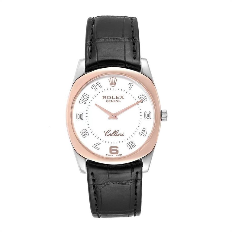 Rolex Cellini Danaos 18K White Rose Gold Black Strap Mens Watch 4233. Manual winding movement. 18k white and rose gold rounded rectangular case 34.0 mm. Rolex logo on a crown. 18K rose gold bezel. Scratch resistant sapphire crystal. White dial with