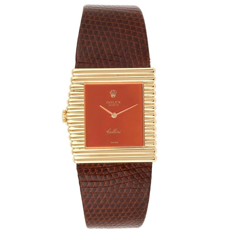 Rolex Cellini Midas Yellow Gold Orange Mirror Dial Vintage Watch 4017. Manual winding movement. 18k yellow gold rectangular asymmetrical case 27.5 x 28.0 mm. Winding crown at 9. 18k yellow gold wide ribbed bezel. Scratch resistant sapphire crystal.