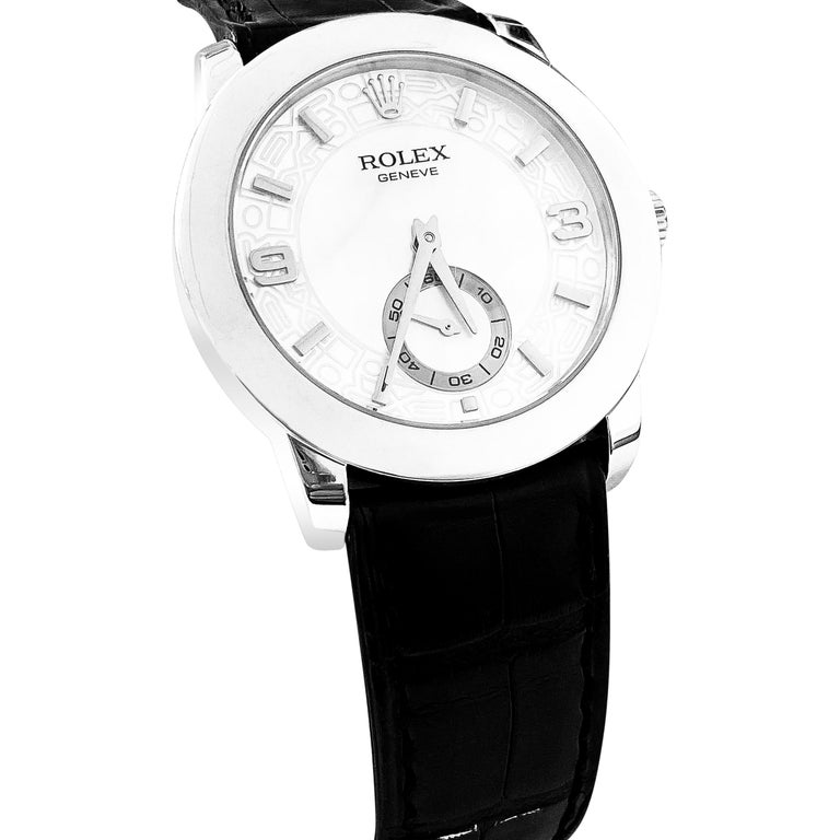 Rolex Cellini Platinum Men's Watch 5240. Platinum case (35mm diameter). Mother of pearl decorated dial with Arabic numerals and baton markers; seconds subdial.  Black croc strap band with platinum Rolex buckle.  Comes with rolex box.  Beautiful mens