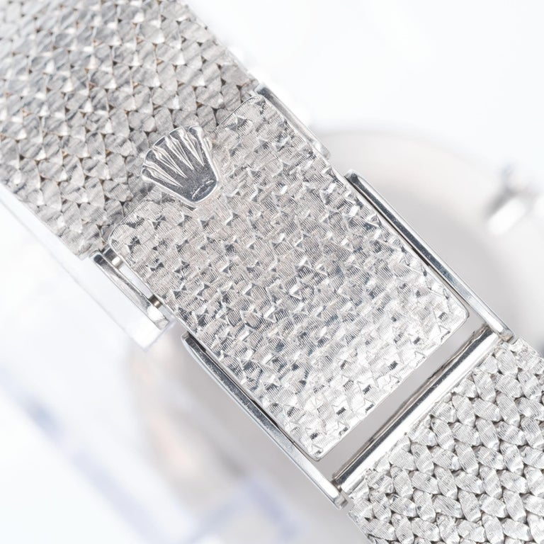 Rolex Cellini 18k white gold mesh band white dial wristwatch.   Length: 7 ¾ Inches – can be shortened Length: 31.02mm Width: 30.52mm Band width at case: 18.11mm Case thickness: 51.1mm Band: 18k white gold mesh Crystal: sapphire Dial: white with
