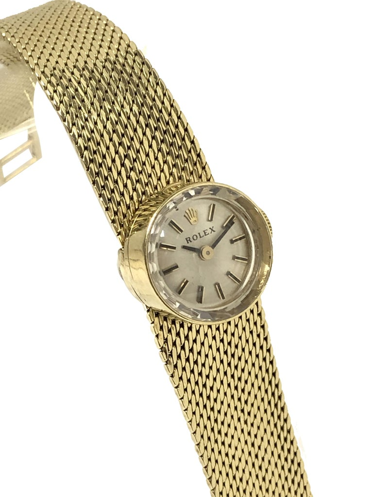 Circa 1960 Rolex Chameleon Ladies Wrist Watch, This unique Watch is on a 14k Yellow Gold soft woven style bracelet that is removable to be interchanged with 7 different color Leather and Fabric straps, each with a Yellow Gold filled Rolex buckle and