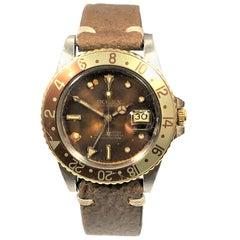 """Rolex circa 1975 Steel and 14 Karat Gold Ref 1675 GMT """"Root Beer"""" Wristwatch"""