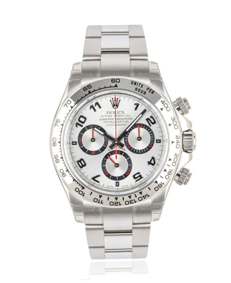 An unworn NOS 40mm Cosmograph Daytona in white gold by Rolex, featuringa silverracing dial with red detailing. Like all Daytona's this model features a tachymetric scale, three counters and three pushers, making it the ultimate high-performance