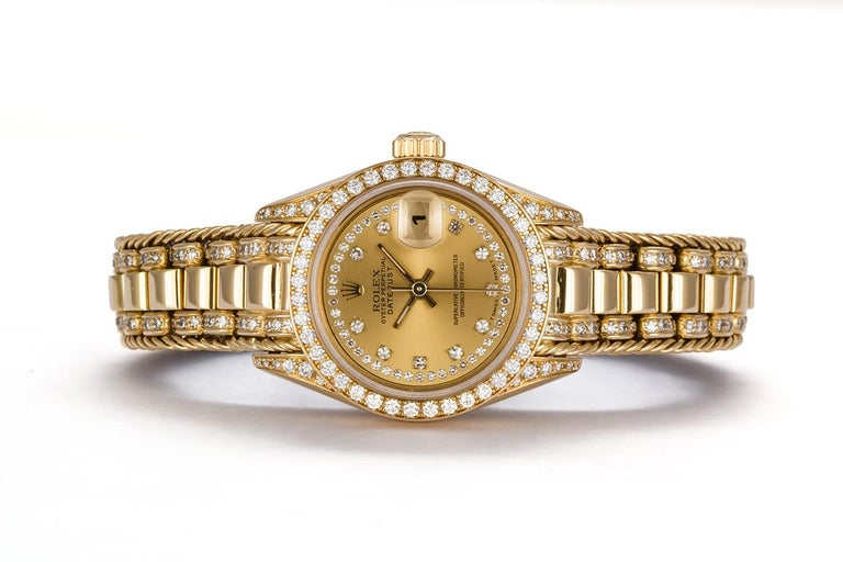 We are pleased to offer this Rare 1993 Rolex Crown Collection Ladies Datejust President 69238. This very rare version of the classic Rolex ladies 26mm watch features a solid 18k Yellow gold case with factory diamond lugs, factory diamond bezel and a