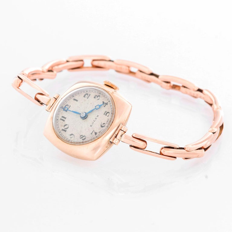 Rolex Cushion Shaped Oyster Rose Gold Watch - Manual winding. Rose gold ( 20 x 20 mm ). Ivory Guilloche dial with Arabic numerals and blue Breguet hands. Rose gold link stretchy bracelet; will fit up to a 7 1/4 inch wrist. Pre-owned with custom box.