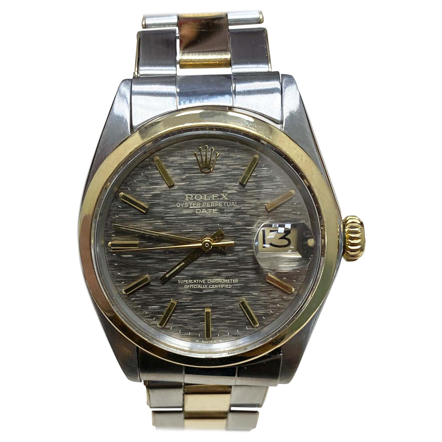 Rolex Date 1500 14 Karat Yellow Gold Stainless Steel