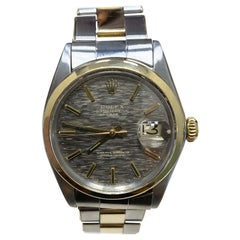 Rolex Date 1500 14 Karat Yellow Gold Stainless Steel