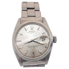Rolex Date 1500, Silver Dial, Certified and Warranty