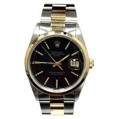 Rolex Date 15203 Black Dial 18 Karat Yellow Gold Stainless Steel