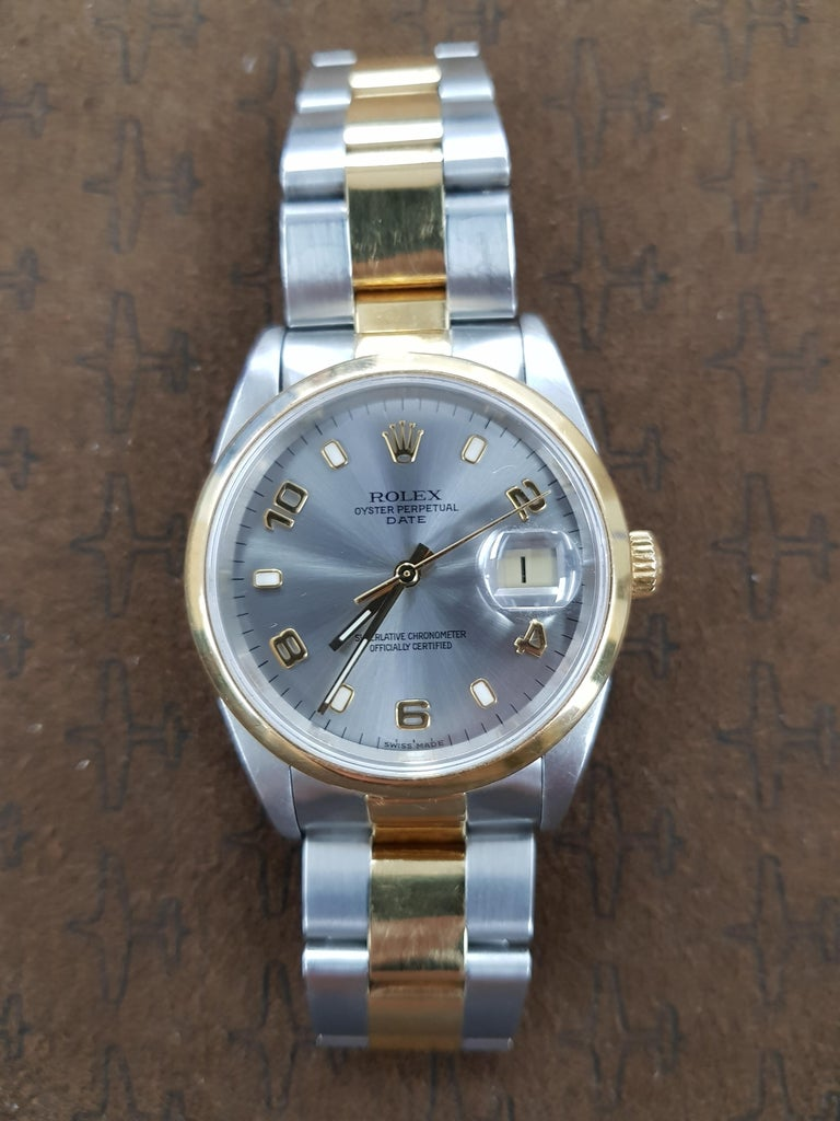 Bi-metal Rolex Date in gold and stainless steel with a 34 mm dial. This watch comes with full Rolex certification.