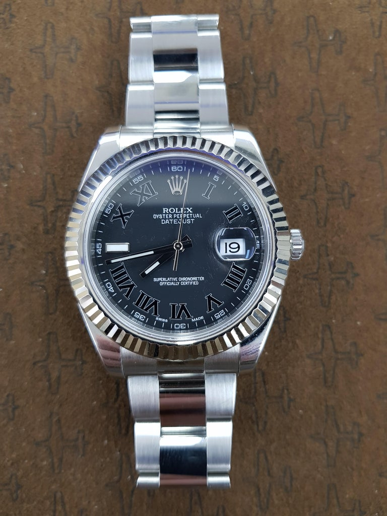 Rolex Date Just 2 in stainless steel with a blue dial and 41 mm fluted bezel. This watch comes with full Rolex certification.