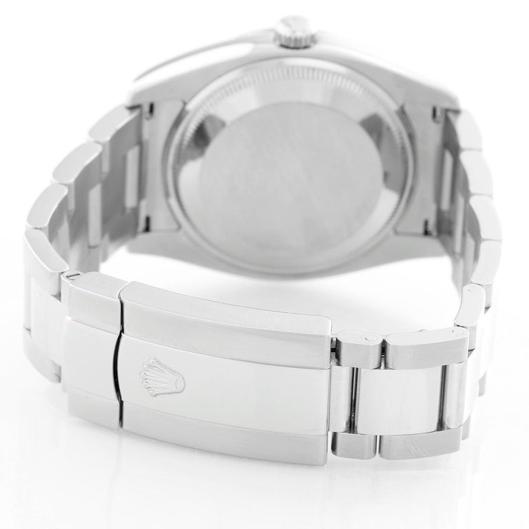Rolex Date Oyster Perpetual Men's Watch 115200 - Automatic winding. Stainless Steel ( 34 mm ) Smooth bezel. White dial with luminous hour markers. Oyster bracelet with deployant buckle. Pre-owned with Rolex box and books.