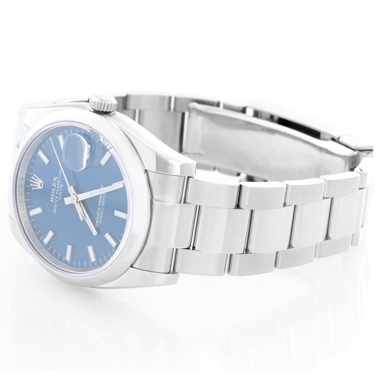 Rolex Date Oyster Perpetual Men's Watch 115200 - Automatic winding. Stainless Steel ( 34 mm ) Smooth bezel. White dial with luminous hour markers. Oyster bracelet with deployant buckle. Pre-owned with custom box .