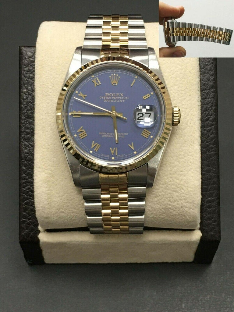 Style Number: 16233  Serial: L583***  Model: Datejust  Case Material: Stainless Steel  Band: 18K Yellow Gold & Stainless Steel  Bezel:  18K Yellow Gold  Dial: Purple  Face: Sapphire Crystal  Case Size: 36mm  Includes:  -Elegant Watch Box -Certified