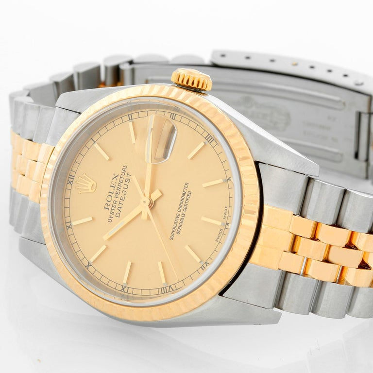 Rolex Datejust 2-Tone Men's Steel & Gold Watch 16233 - Automatic winding, Quickset, sapphire crystal. Stainless steel case with 18k yellow gold fluted bezel (36mm diameter). Champagne dial with stick hour markers. Stainless steel and 18k yellow gold
