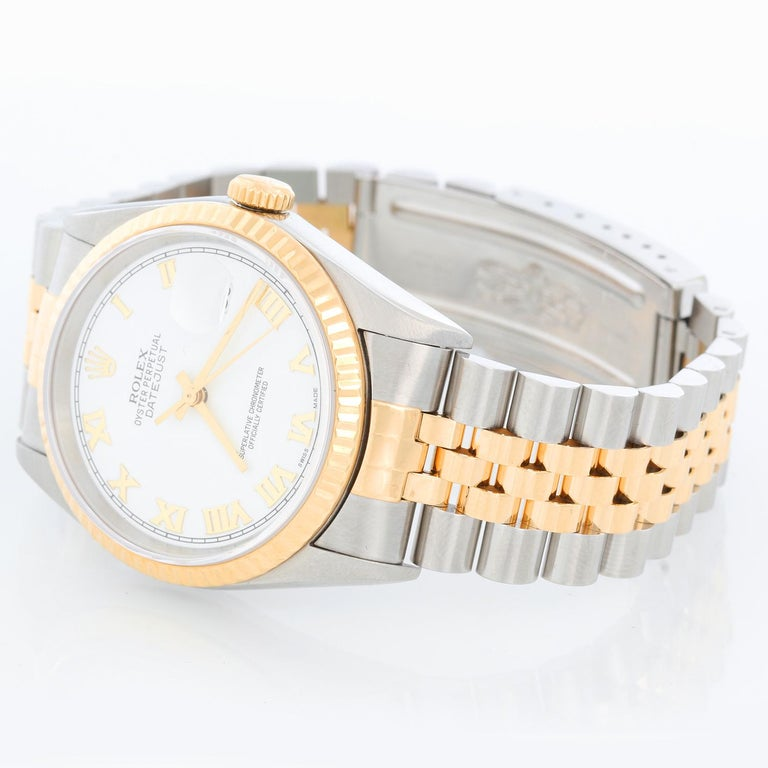 Rolex Datejust 2-Tone Men's Steel & Gold Watch 16233 - Automatic winding, Quickset, sapphire crystal. Stainless steel case with yellow gold bezel (36mm diameter). White dial with Roman numerals. Stainless steel and 18k yellow gold Jubilee bracelet.