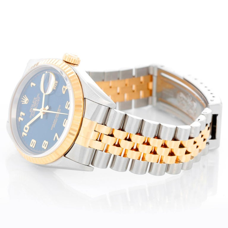 Rolex Datejust 2-Tone Men's Steel & Gold Watch 16233 - Automatic winding, Quickset, sapphire crystal. Stainless steel case with yellow gold bezel (36mm diameter). Blue dial with Arabic numerals . Stainless steel and 18k yellow gold Jubilee bracelet.