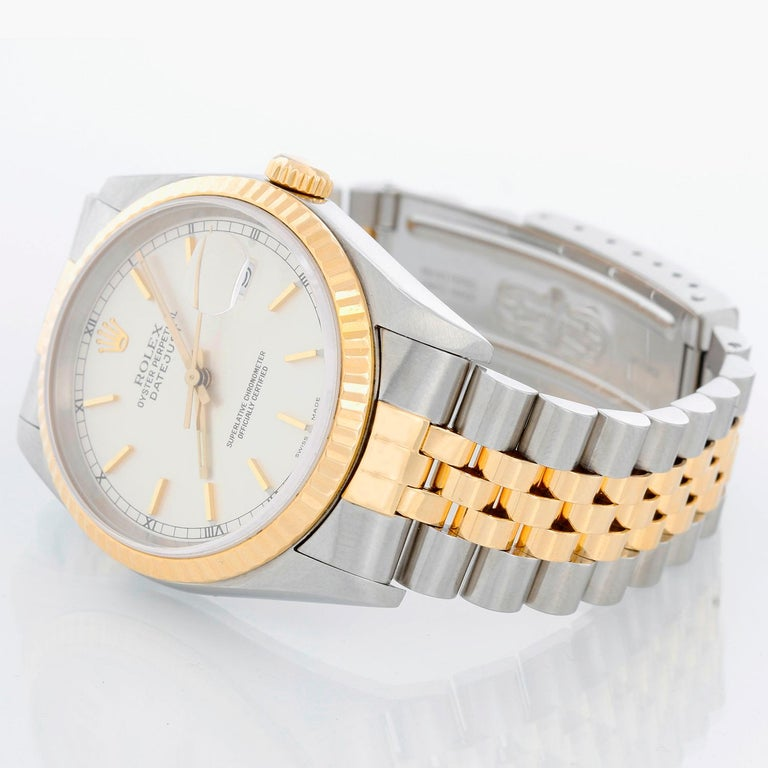 Rolex Datejust 2-Tone Men's Steel & Gold Watch 16233 - Automatic winding, Quickset, sapphire crystal. Stainless steel case with yellow gold bezel (36mm diameter). Silver stick dial . Stainless steel and 18k yellow gold Jubilee bracelet. Pre-owned