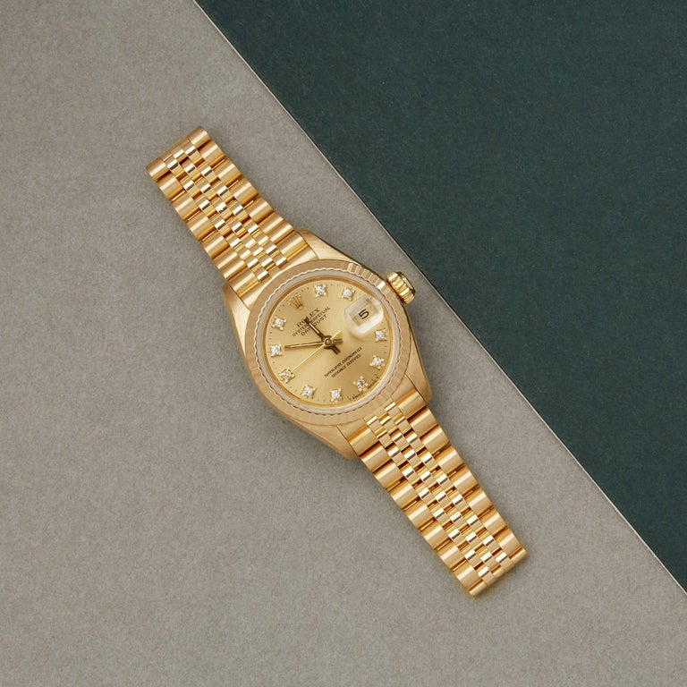 Xupes Reference: W007648 Manufacturer: Rolex Model: Datejust Model Variant: 26 Model Number: 69178G  Age: 1988 Gender: Ladies Complete With: Rolex Box & Service Pouch Dial: Champagne With Diamond Markers Glass: Sapphire Crystal Case Size: 26mm Case