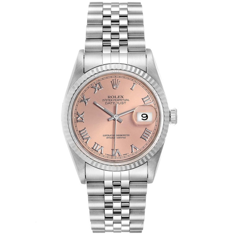 Rolex Datejust 36 Steel White Gold Salmon Dial Mens Watch 16234. Officially certified chronometer self-winding movement. Stainless steel oyster case 36 mm in diameter. Rolex logo on a crown. 18k white gold fluted bezel. Scratch resistant sapphire
