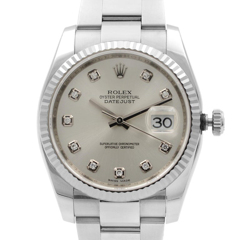 Factory Diamond Dial. 2012 Card Warranty Card. Rolex Serial tag and Rolex Tag is also included.  Comes with Original Box and Papers. Covered By 3 Year Chronostore Warranty. Details: Model Number 116234 Brand Rolex Department Men Style Dress/Formal,