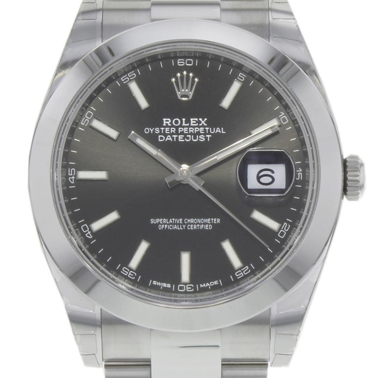 (19543) This brand new Rolex Datejust 41 126300 bkio is a beautiful men's timepiece that is powered by an automatic movement which is cased in a stainless steel case. It has a round shape face, date dial and has hand sticks style markers. It is