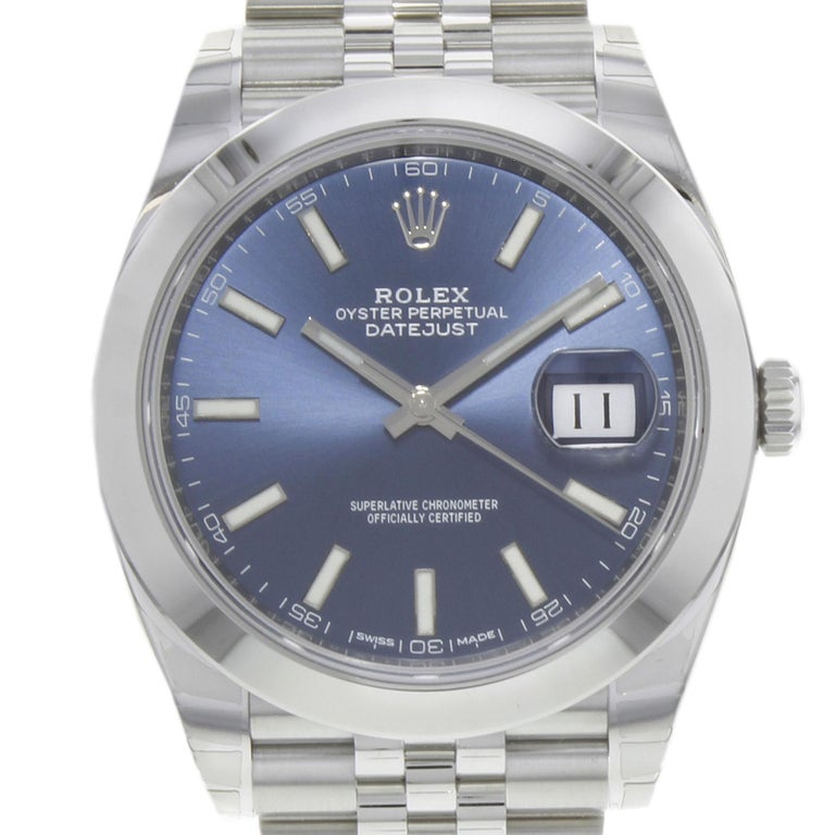 (19537) This brand new Rolex Datejust 41 126300 blij is a beautiful men's timepiece that is powered by an automatic movement which is cased in a stainless steel case. It has a round shape face, date dial and has hand sticks style markers. It is