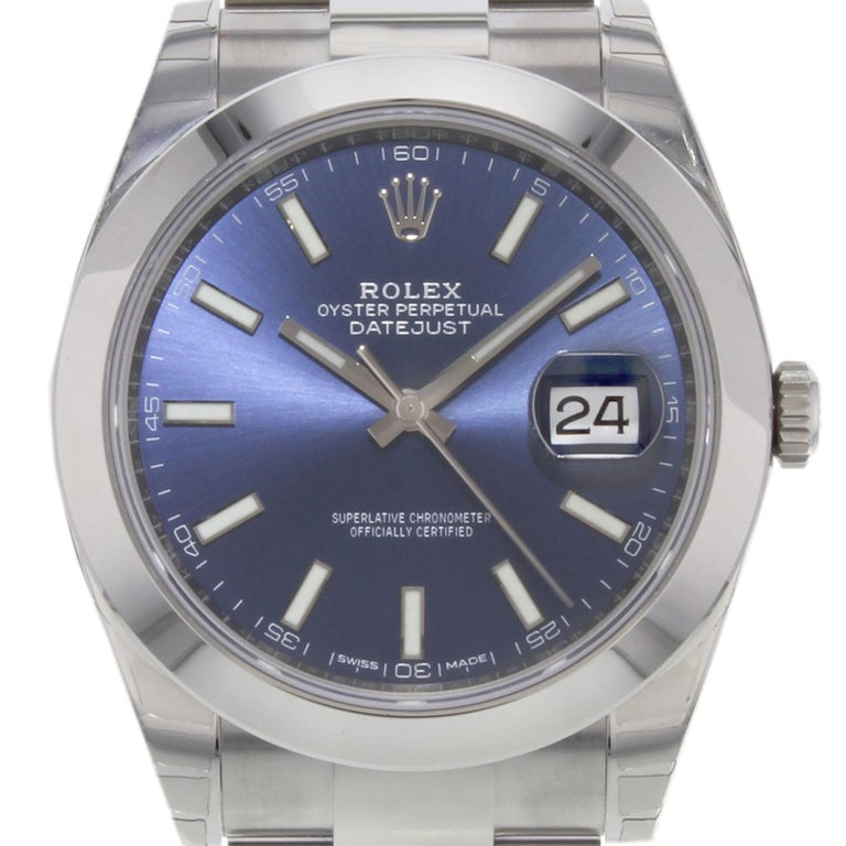(19561) This brand new Rolex Datejust 41 126300 blio is a beautiful men's timepiece that is powered by an automatic movement which is cased in a stainless steel case. It has a round shape face, date dial and has hand sticks style markers. It is