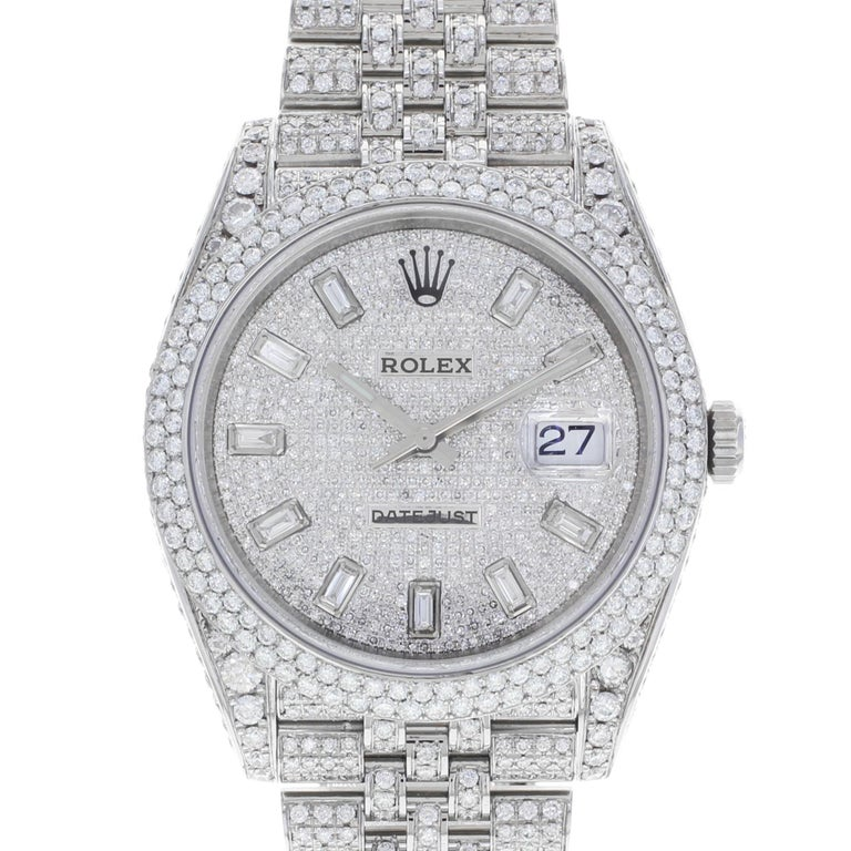 This pre-owned Rolex Datejust 41 126300  is a beautiful men's timepiece that is powered by an automatic movement which is cased in a stainless steel case. It has a round shape face, date, diamonds dial and has hand diamonds style markers. It is