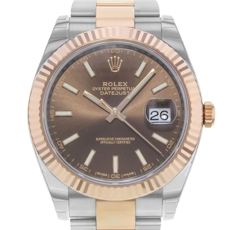 (15819) This brand new Rolex Datejust 41 126331 choio is a beautiful men's timepiece that is powered by an automatic movement which is cased in a stainless steel case. It has a round shape face, date dial and has hand sticks style markers. It is