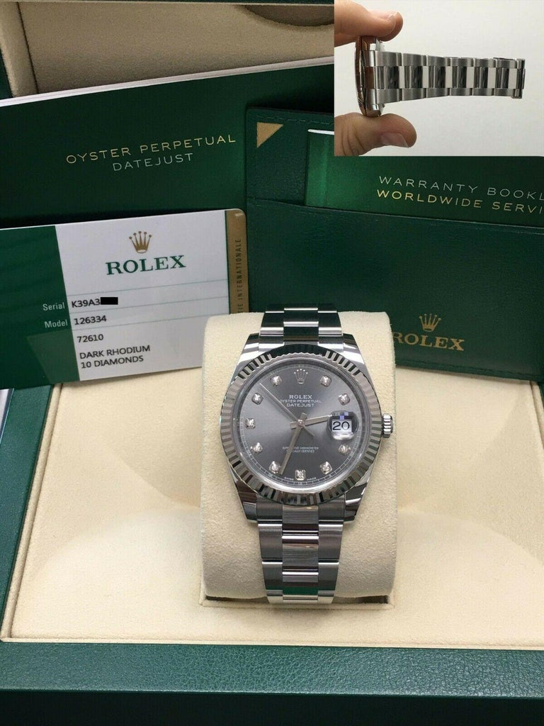 Style Number: 126334  Serial: K39A3***  Year: 2018  Model: Datejust 41  Case Material: Stainless Steel  Band: Stainless Steel  Bezel:  18K White Gold  Dial: Dark Rhodium Diamond Dial - Original Factory Dial  Face: Sapphire Crystal   Case Size: 41mm