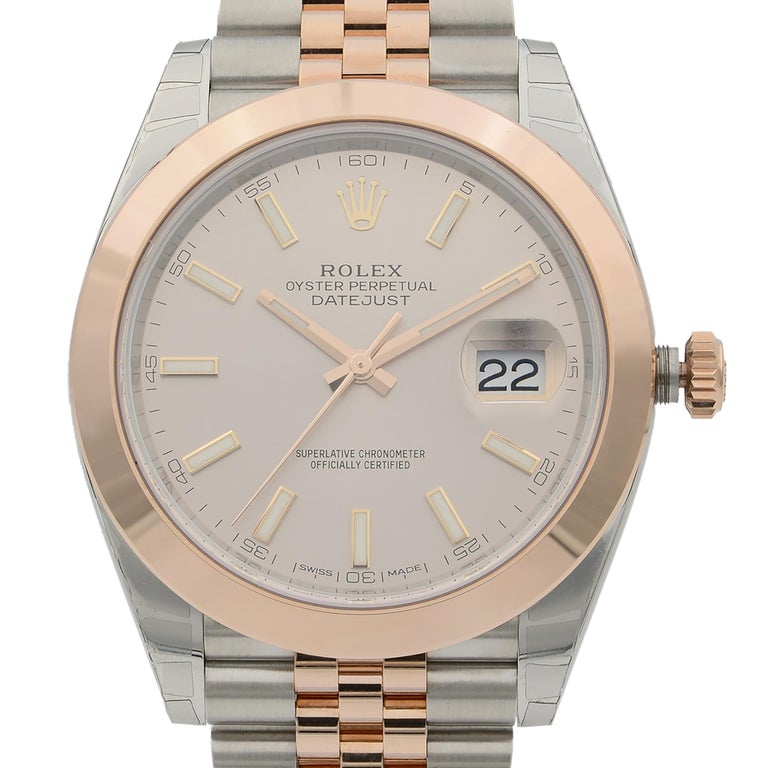 This  never been worn  Rolex Datejust 41 126301  is a beautiful men's timepiece that is powered by mechanical (automatic) movement which is cased in a stainless steel case. It has a round shape face, date indicator dial and has hand sticks style