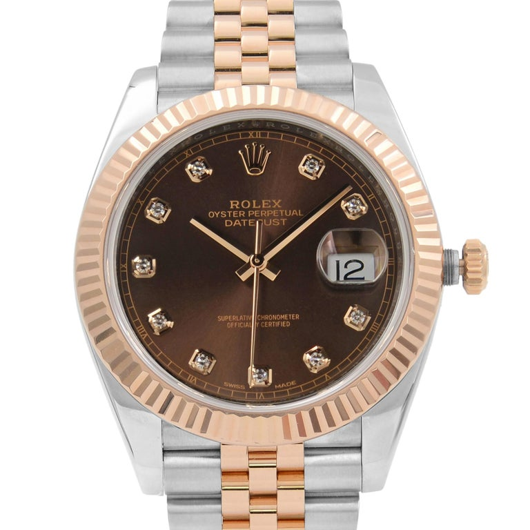 This pre-owned Rolex Datejust 41 126331 is a beautiful men's timepiece that is powered by mechanical (automatic) movement which is cased in a stainless steel case. It has a round shape face, date indicator, diamonds dial and has hand diamonds style