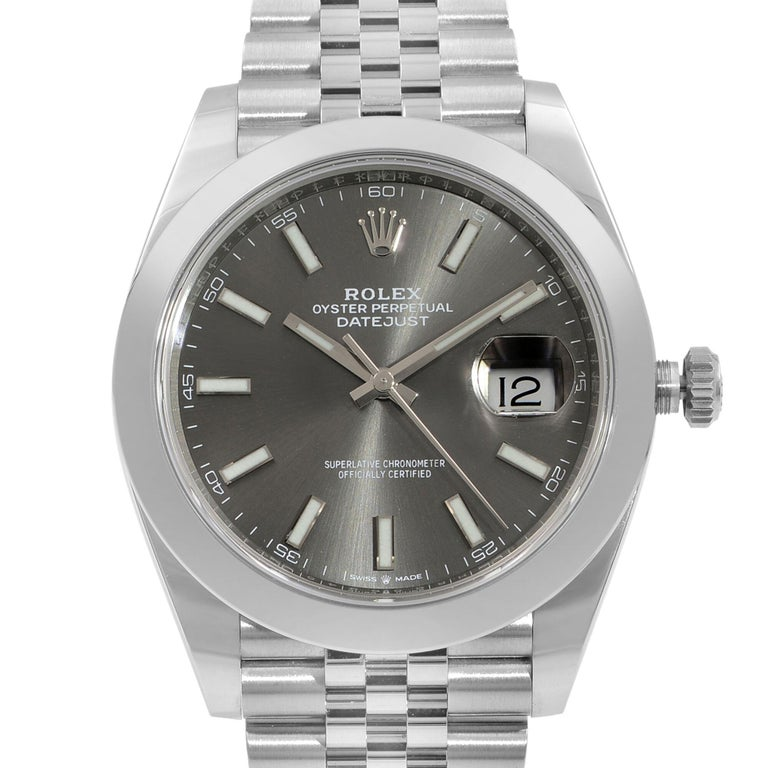 This display model Rolex Datejust 41 126300-RHOSJ is a beautiful men's timepiece that is powered by mechanical (automatic) movement which is cased in a stainless steel case. It has a round shape face, date indicator dial and has hand sticks style