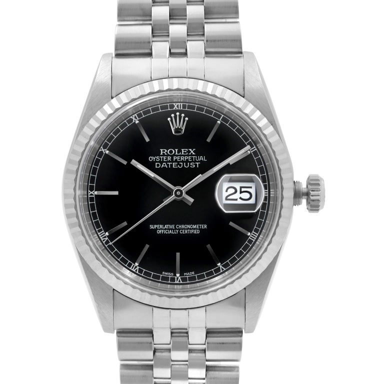 Refinished Dial. Pre Owned Rolex Datejust Black Dial Steel & 18K White Gold Automatic Men's Watch 16234.  The watch was produced in 1999. This Timepiece Features:  Stainless Steel Case, Steel Jubilee Bracelet. Fluted White Gold Bezel. Black Dial