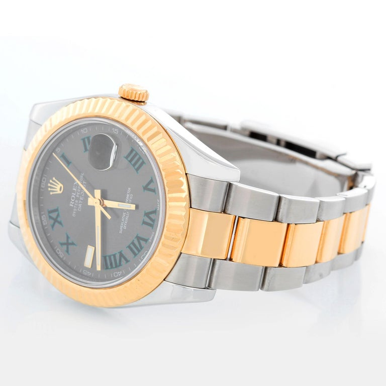 Rolex Datejust II  Men's 2-Tone Steel & Gold 41mm Watch 116333 - Automatic winding, Quickset, sapphire crystal. Stainless steel case with 18k yellow gold fluted bezel  (41mm diameter). Slate Gray dial with green Roman numerals; Marker at 9 o'clock.